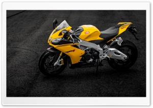 Aprilia RSV4 Yellow Motorcycle On Road HD Wide Wallpaper for 4K UHD Widescreen desktop & smartphone
