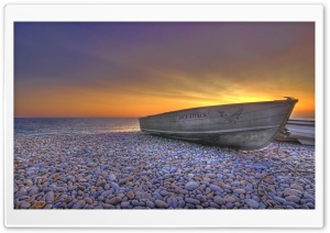 Boat On Pebbles Beach HD Wide Wallpaper for 4K UHD Widescreen desktop & smartphone