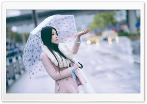 Cute Girl in the Rain with...