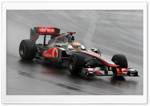F1 Car On A Wet Track HD Wide Wallpaper for 4K UHD Widescreen desktop & smartphone
