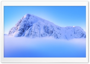 Snowy Mountain Peak Above Clouds