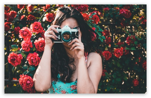 Download Woman in Floral Dress Taking a Picture HD Wallpaper