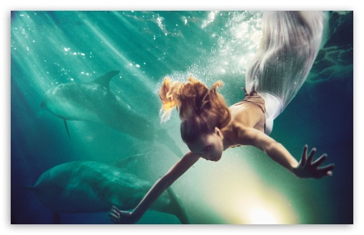 Download Woman Swimming with Dolphins HD Wallpaper